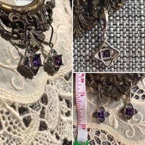 Jewelry - Silver dangle earrings with purple gemstone.